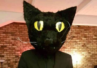 Man Dresses As His Black Cat For Halloween. The Cat's Reaction Is Priceless!